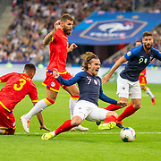 PARIS, FRANCE - September 10:  Antoine Griezmann #7 of France is fouled in the penalty area while challenged by Marc Vales #3 of Andorra and Moisés San Nicolás #15 of Andorra resulting in a penalty awarded to France during the France V Andorra, UEFA European Championship 2020 Qualifying match at Stade de France on September 10th 2019 in Paris, France (Photo by Tim Clayton/Corbis via Getty Images)