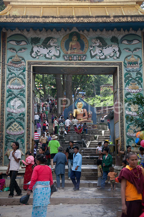 An arc leading into and up the steep steps to the Buddhist Swayambhunath temple complex, also called the Monkey Temple.