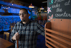 Sal Bednarz, owner of the late Actual Cafe and Victory Burger restaurants on San Pablo Avenue, poses for a photograph in his closed establishment, Tuesday, Jan. 31, 2017 in Oakland, Calif. Bednarz says he was forced to close by rising costs and a dearth of staff. (Photo by D. Ross Cameron)