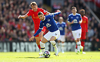 Football - 2016 / 2017 Premier League - Liverpool vs. Everton<br /> <br /> Kevin Mirallas of Everton and Lucas of Liverpool during the match at Anfield.<br /> <br /> COLORSPORT/LYNNE CAMERON