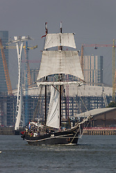 © Licensed to London News Pictures. 15/06/2016. LONDON, UK.  The historic tall ship, Jantje passes through the Thames Barrier, in front of the Thames Cable Car and the O2 on the River Thames. The Sail Royal Greenwich Tall Ship Festival runs until this Sunday, 18th Septmeber.  Photo credit: Vickie Flores/LNP
