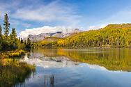Reflection of fall colors on Bonnie Lake along the Matanuska Valley in Southcentral Alaska. Afternoon.
