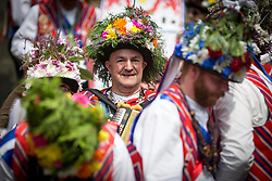 © Licensed to London News Pictures. 23/08/2015 . Uppermill , Saddleworth , Greater Manchester , UK. <br /> The Saddleworth Ruschart Festival in Uppermill today (Sunday 23rd Aug 2015).<br /> A rushcart built of moorland rushes is pulled by Morris Dancers from Uppermill village square to St Chad's Church.  The tradition arises from the laying of rushes on the church floor to keep it warm in winter.<br /> <br /> Photo credit : Chris Bull / LNP