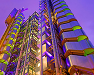 In this photograph we can see in fantastic high detail the great architectural statement made by Richard Rogers' Lloyds Building at Number One Lime street in London. This stunning building has been designed with all the functional elements that allow a building to live placed around the outside making up the skeleton of the building.<br /> <br /> This has given the passer by the ability to see how this building lives and breaths in a way that is almost totally unique to the Llodys Building. It has become a true symbol of the city of Westminster and the financial heart of the City of London. Built in the 1980's it has amazing structure and from and seen in the evening we this given this hugely impressive display of green and purple lights which allow for a truly magical photograph.