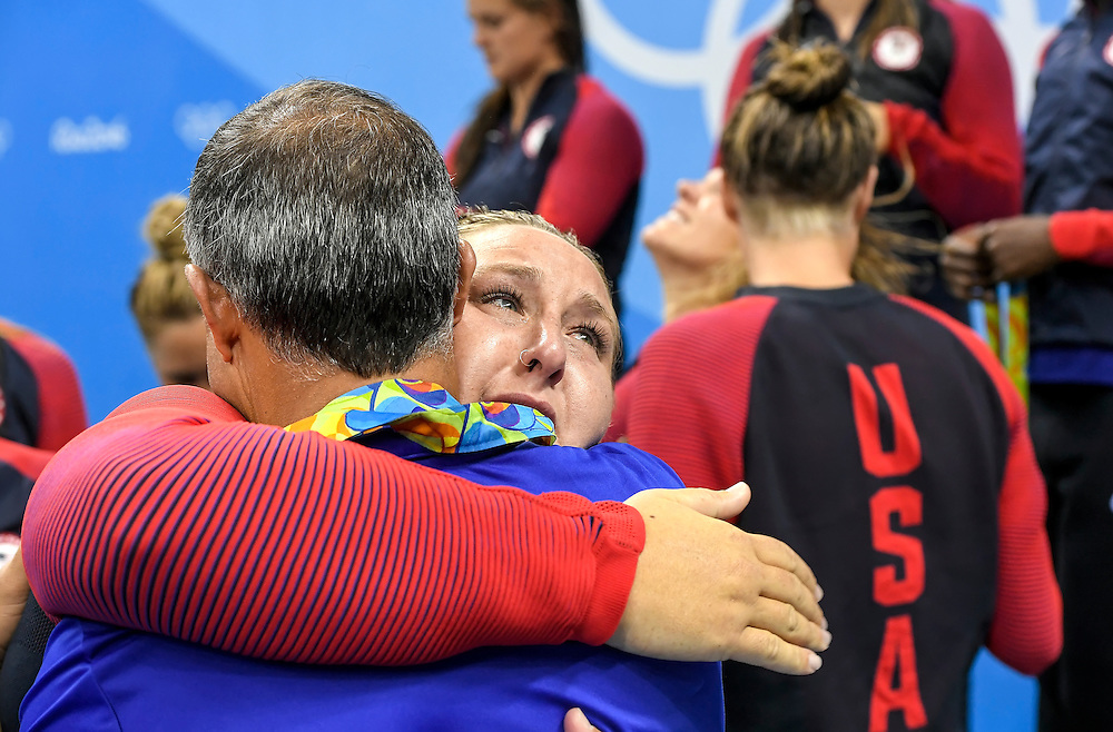 United States water polo player Melissa Seidemann hugged her head coach, Adam Krikorian, following the medal ceremony for the team's gold medal ceremony in the 12-5 victory over Italy on Friday at Olympic Aquatics Stadium during the 2016 Summer Olympics Games in Rio de Janeiro, Brazil.