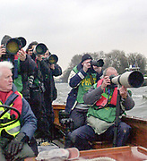 Putney. London.  2004 University Boat Race,  Championships Course, Putney to Mortlake. <br /> Press Photographers at work  Oxford and Cambridge, boat race,  <br /> <br /> [Mandatory Credit Peter SPURRIER]