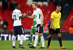 Tottenham Hotspur's Harry Kane (centre) and Victor Wanyama shake hands as Watford's Richarlison (right) looks dejected after the Premier League match at Wembley Stadium. London.