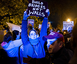 November 11, 2016 - Columbus, Ohio, U.S - Tensions grew as anti-Trump Protesters left the area being confronted by supporters of Donald Trump President Elect. Here a young anti-Trump protester holds a sign reading ''Build bridges not walls' (Credit Image: © Seth Herald via ZUMA Wire)