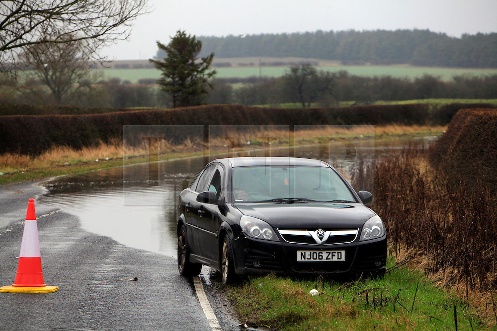 © London News Pictures. 06/01/2016. A car is abandoned on Berwick Hill, Ponteland, North east England. Large parts of the UK continue to suffer flooding after more heavy rain.  Areas of Northumberland and the North East have suffered with many being displaced from their homes as a result of flooding. Photo credit: Adam Davies/LNP