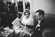After the wedding,during the reception in the Hôtel Ritz, François and Edouard look i the local paper:<br /> France -Soir which has my picture of her on the front page.<br /> Therefor a picture of a couple looking at their picture in a photo taken that same day, easy today, impossible in 1960!.<br /> <br /> Après le mariage, lors de la réception de l'Hôtel Ritz, François et Edouard regardent le journal local : France -Soir qui a ma photo d'elle sur la première page .<br /> Une image d'un couple regardant sa photo dans une photo prise ce jour-là même, facile aujourd'hui , impossible en 1960 !.