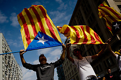 October 3, 2017 - Barcelona, Catalonia, Spain - Two boys wave  estelada or pro-independence flags during a protest against Spanish police brutality in Barcelona. A general strike goes over Catalan territory to protest against brutality by police during a referendum on the region's secession from Spain that left near nine  hundred of people injured. (Credit Image: © Jordi Boixareu via ZUMA Wire)