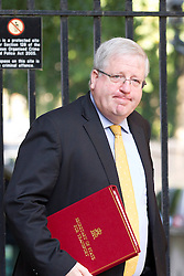 "© Licensed to London News Pictures. 29/08/2013. London, UK. Transport Secretary Patrick McLoughlin arrives for a meeting of the British cabinet on Downing Street in London today (29/08/2013) as a recalled British Parliament prepares to debate the possibility of ""direct"" military action over recent reports an alleged chemical weapons attack in Syria. Photo credit: Matt Cetti-Roberts/LNP"