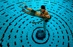 """SPA, BELGIUM - Matgen and Claire Renaud, of Arlon, Belgium, enjoy a session in the """" Aqua Relax """" pool at Le Thermes de Spa. Health and beauty spas the world over, take their name from the original spa in Spa, Belgium where visitors have been coming for hundreds of years to """" take the waters """" at Les Thermes de Spa  . (Photo © Jock Fistick)"""