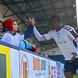 TELFORD COPYRIGHT MIKE SHERIDAN 30/3/2019 - GOAL. Dan Udoh of AFC Telford celebrates with a young fan after scoring to make it 1-0 during the Vanarama National League North fixture between AFC Telford United and Blyth Spartans at the New Bucks Head.