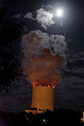 full moon over atomic power plant cooling tower