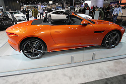 08  February 2013: 2014 Jaguar F Type S. Chicago Auto Show, Chicago Automobile Trade Association (CATA), McCormick Place, Chicago Illinois<br /> <br /> 2013 JAGUAR F-TYPE: An all-new model that broadens Jaguar's sports and GT lineup with be pulling in the crowds during the 105th edition of the Chicago Auto Show. It's the 2013 Jaguar F-Type that represents a return to the company's heart: a two-seat, convertible sports car focused on performance, agility and driver involvement. The F-Type introduces a new design language for Jaguar, with bold, clean lines, a deployable rear spoiler and hidden door handles. For 2013, there are three F-types offered - F-Type, F-Type S and the F-Type V8 S, powered respectively by the new Jaguar supercharged 3-liter V-6 engine in 340 horsepower and 380hp outputs and a 495hp 5 liter supercharged V-8. All engines drive through an eight-speed 'Quickshift' automatic transmission, with steering wheel-mounted paddles for full manual control. Incredible performance numbers for the F-type are listed as 0-to-60 in 5.1 seconds for the F-Type, 4.8 for the S model and 4.2 for the V8 S. Top track speed is 186 mph. Additionally, the F-TYPE S and V8 S models are fitted with the Jaguar Adaptive Dynamics suspension damping system that controls vertical body movement, roll and pitch rates. The F-Type's lightweight soft top folds in 12 seconds at speeds up to 30 mph, and when lowered, the top serves as its own tonneau cover. Inside the asymmetric cabin layout, the enveloping environment is create so that all controls are placed naturally for the driver. There are two audio systems from premium British audio experts Meridian, which places both occupants at the center of their own perfectly focused surround sound field.