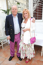 """Willie & Angie Robertson at a party to celebrate the publication of the Paper back edition of """"A Lion Called Christian"""" held at Julie's Restaurant & Bar, 135 Portland Road, London W11 on 28th June 2010."""