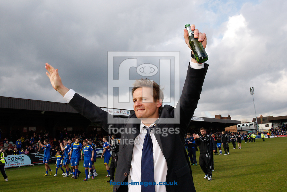 Picture by Andrew Tobin/Focus Images Ltd +44 7710 761829.27/04/2013. AFC Wimbledon manager Neal Ardley celebrates staying up after winning 2-1 during the npower League 2 match at the Cherry Red Records Stadium, Kingston.