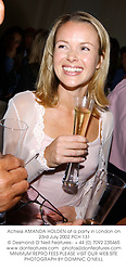 Actress AMANDA HOLDEN at a party in London on 23rd July 2002.PCH 131
