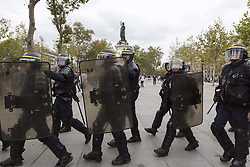 September 15, 2016 - Paris, France - French riot police patrol during a demonstration against the controversial labour reforms of the French government in Paris on September 15, 2016...Opponents of France's controversial labour reforms took to the streets on September 15, 2016 for the 14th time in six months in a last-ditch bid to quash the measures that lost the Socialist government crucial support on the left. Scores of flights in and out of France were cancelled as air traffic controllers went on strike to try to force the government to repeal the changes that became law in July. GEOFFROY VAN DER HASSELT. (Credit Image: © Geoffroy Van Der Hasselt/NurPhoto via ZUMA Press)