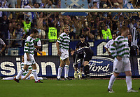 Photo: Greig Cowie<br /> Celtic v Porto. UEFA Cup Final. Seville. 21/05/2003<br /> The Celtic players pick the ball out of the ne