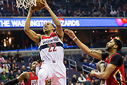 WASHINGTON, USA - February 4: Washington Wizards' Otto Porter (22) tries to dunk the ball against the New Orleans Pelicans at the Verizon Center in Washington, USA on February 4, 2017. The Wizards lead the Pelicans 53-49 at halftime and are trying to claim their 17th straight win at home.