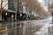 A view of a deserted and wet Swanston Street during COVID-19 in Melbourne, Australia. Victoria has recorded 14 COVID related deaths including a 20 year old, marking the youngest to die from Coronavirus in Australia, and an additional 372 new cases overnight. (Photo by Dave Hewison/Speed Media)