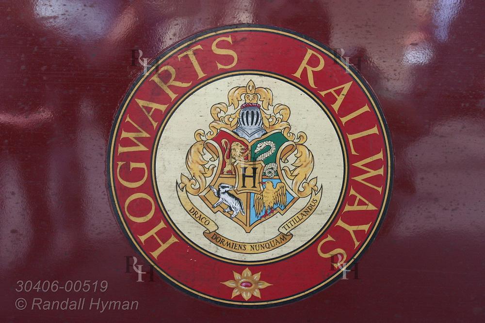 Hogwarts Railways sign adorns Scarborough Spa Express steam train; York, England.