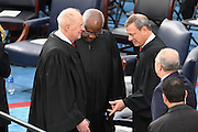 Supreme Court Chief Justice John Roberts, right, talks with Justice Clarence Thomas and Justice Anthony Kennedy, left, during the 68th President Inaugural Ceremony on Capitol Hill January 20, 2017 in Washington, DC. Donald Trump became the 45th President of the United States in the ceremony.