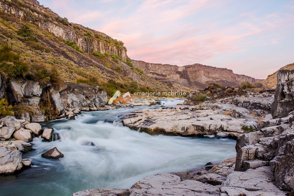 Snake River in the canyon at Auger Falls during sunset, Twin Falls, Idaho.