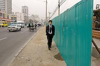 A young man goes to work in Liang Ma Qiao Lu, Beijing, China.