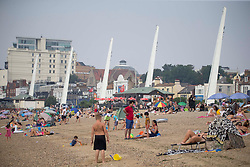 © Licensed to London News Pictures. 12/08/2020 Southend-on-Sea, UK. Members of the public enjoying hazy and warm weather on the Thames Estuary in Southend-on-Sea, Essex. Temperatures have reached 31 degrees in southeast England. Photo credit: Marcin Nowak/LNP