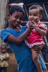 February 6, 2018 - Cox'S Bazar, Bangladesh - A young Rohingya boy and baby seen posing for a photo in Kutupalong refugee camp in Cox's Bazar. More than 800,000 Rohingya refugees have fled from Myanmar Rakhine state since August 2017, as most of them keep trying to cross the border to reach Bangladesh every day. (Credit Image: © Marcus Valance/SOPA via ZUMA Wire)
