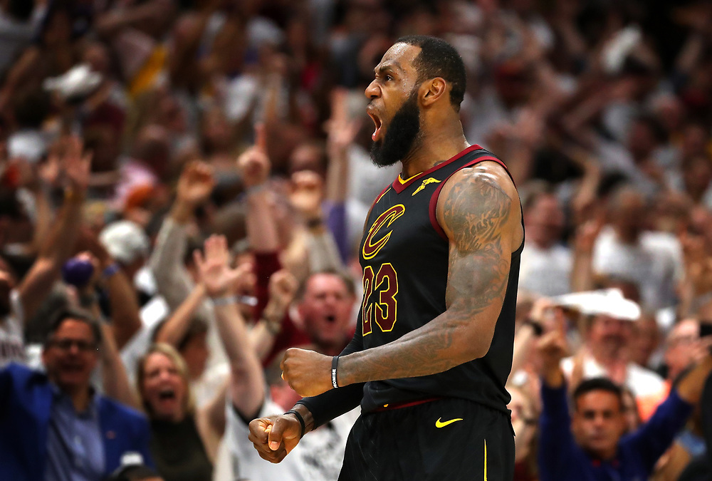 CLEVELAND, OH - MAY 25:  LeBron James of the Cleveland Cavaliers reacts after a basket in the fourth quarter against the Boston Celtics during Game Six of the 2018 NBA Eastern Conference Finals at Quicken Loans Arena on May 25, 2018 in Cleveland, Ohio. NOTE TO USER: User expressly acknowledges and agrees that, by downloading and or using this photograph, User is consenting to the terms and conditions of the Getty Images License Agreement.  (Photo by Gregory Shamus/Getty Images)