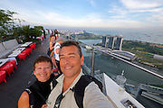 Singapore. Marina Bay Sands Hotel and Central Business District seen from Altitude restaurant and bar at the 61st and 62nd floor of One Raffles Place.<br /> Heimo Aga and Nicole Schmidt.
