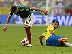 July 2, 2018 - Samara, Russia - July 2, 2018, Russia, Samara, FIFA World Cup 2018, 1/8 finals. Football match of Brazil - Mexico at the stadium Samara - Arena. Player of the national team Hctor Herrera (16), Roberto Firmino  (Credit Image: © Russian Look via ZUMA Wire)