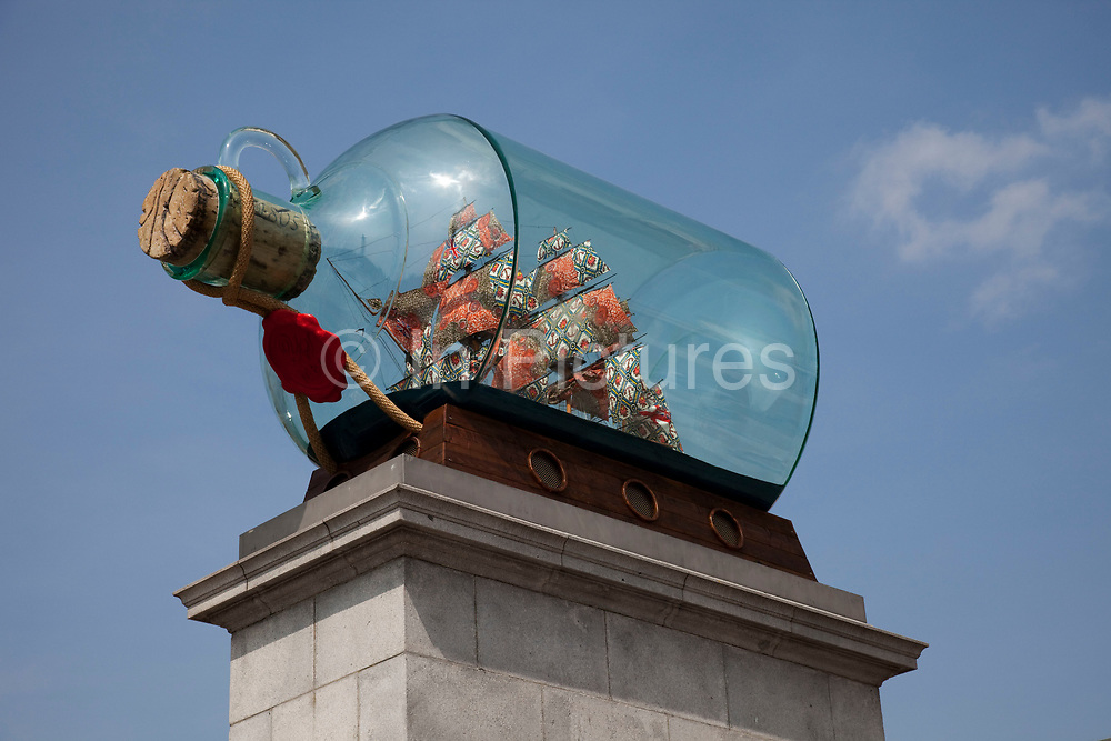 A replica of Lord Nelson's ship Victory, set inside a giant bottle and made by artist Yinka Shonibare, is the latest addition to the fourth plinth in London's Trafalgar Square. The artwork, entitled Nelson's Ship in a Bottle has 31 sails, as did Victory when she went into battle. The sails look like Shonibare's trademark African cloths, woven in England and printed with African patterns, which he has used repeatedly to subvert iconic pieces of western art. They are actually made of traditional sail canvas, hand-sewn, and hand printed in batik designs by the artist.