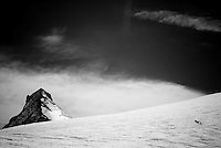 A group of skiers climb the Col de Valpelline during the final day of the Haute Route traverse in Switzerland.