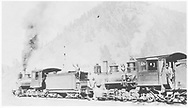"""Two RGS class 60 locomotives pulling freight.<br /> RGS  Vance Junction, CO  ca 1915<br /> In book """"Southern, The: A Narrow Gauge Odyssey"""" page 89<br /> See RD155-084 for original."""