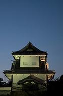 An entrance gate to the grounds of Kanazawa Castle at dusk, Kanazawa, Japan