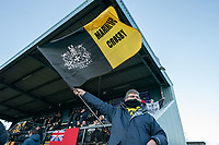 Football - 2020 / 2021 FA Trophy - Round Two - Marine vs Hyde United - Rossett Park<br /> <br /> <br /> Marine FC fan waves a flag<br /> <br /> <br /> COLORSPORT/TERRY DONNELLY
