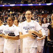 Breanna Stewart, (center), UConn, with team mates after their sides victory during the UConn Huskies Vs USF Bulls Basketball Final game at the American Athletic Conference Women's College Basketball Championships 2015 at Mohegan Sun Arena, Uncasville, Connecticut, USA. 9th March 2015. Photo Tim Clayton