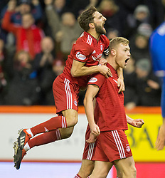 Aberdeen's Sam Cosgrove (right) celebrates scoring his side's first goal of the game during the Ladbrokes Scottish Premiership match at Pittodrie Stadium, Aberdeen.