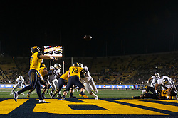 California quarterback Chase Garbers (7) passes from the end zone against Nevada during the fourth quarter of an NCAA college football game, Saturday, Sept. 4, 2021, in Berkeley, Calif. (AP Photo/D. Ross Cameron)