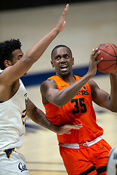 Feb 25, 2021; Berkeley, California, USA; Oregon State Beavers forward Dearon Tucker (35) drives past California Golden Bears forward Andre Kelly (22) during the first half of an NCAA college basketball game at Haas Pavilion. Mandatory Credit: D. Ross Cameron-USA TODAY Sports