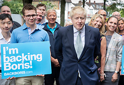 © Licensed to London News Pictures. 25/06/2019. London, UK. Leadership candidate Boris Johnson meets with local Conservative Party volunteers as he campaigns in East Sheen, south west London. Mr Johnson is campaigning in various locations in the south east of England today. Photo credit: Peter Macdiarmid/LNP