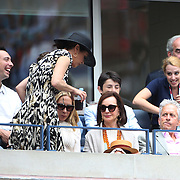 Michael Douglas, (right), watching Flavia Pennetta, Italy, and Roberta Vinci Italy, in the Women's Singles Final match during the US Open Tennis Tournament, Flushing, New York, USA. 12th September 2015. Photo Tim Clayton