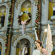Statue of an angel against the backdrop of the main altar in the Cathedral of San Gervasio (Catedral De San Gervasio) in Valladolid in the heart of Mexico's Yucatan Peninsula.