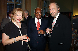 Left to right, LADY ANTONIA FRASER, TREVOR MACDONALD and ED VICTOR at a party to celebrate the publication of 'A History of The English Speaking Peoples Since 1900' hosted by Andrew Roberts and Susan Gilchrist at the English-Speaking Union, 37 Charles Street, London W1 on 11th September 2006.<br />