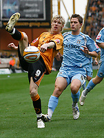 Photo: Steve Bond.<br />Wolverhampton Wanderers v Coventry City. Coca Cola Championship. 06/10/2007.Andy Keogh (L) attempts to lift the ball over Michael Doyle